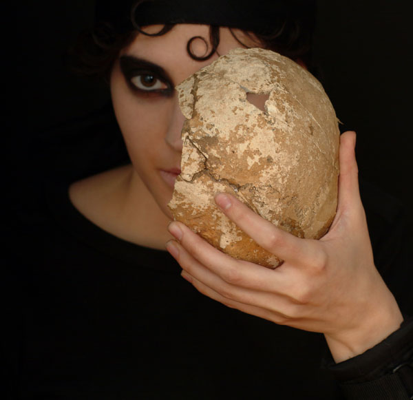 tm holding a real human bone fragment